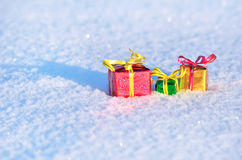 Christmas gifts in the snow. Royalty Free Stock Images