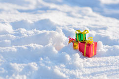 Christmas gifts in the snow. Stock Images