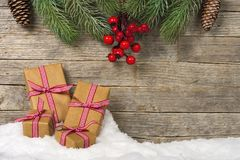 Christmas gifts on snow royalty free stock image