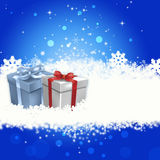 Christmas Gifts. Snowflake background with Christmas Gifts Stock Photos