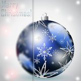 Christmas Gifts. Snowflake background with a beautiful ball and place for text Royalty Free Stock Images