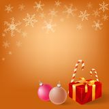 Christmas gifts on snowy flake background Royalty Free Stock Photos
