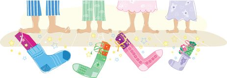 Christmas gifts in socks Stock Images