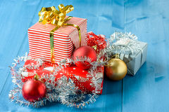 Christmas gifts. With some ornaments on a blue background Stock Images