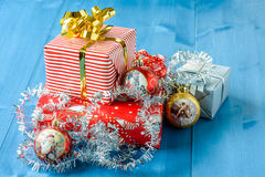 Christmas gifts. With some ornaments on a blue background Royalty Free Stock Photo