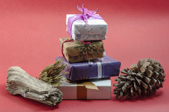 Christmas gifts. Stack of christmas gifts on red background Royalty Free Stock Photos