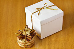 Christmas gifts: a surprise and ginger cookies. Christmas gifts on the table: a surprise in the box and ginger cookies Royalty Free Stock Photo