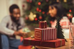 Christmas gifts on table. Selective focus of various christmas gifts on table royalty free stock photo