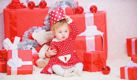 Christmas gifts for toddler. Things to do with toddlers at christmas. Gifts for child first christmas. Little baby girl. Play near pile of gift boxes. Family royalty free stock image