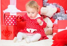 Christmas gifts for toddler. Things to do with toddlers at christmas. Little baby girl play near pile of gift boxes. Family holiday. Gifts for child first royalty free stock images