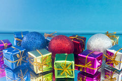 Christmas gifts and toys on a blue background Stock Images