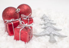 Christmas gifts. And tree on the snow Royalty Free Stock Photo