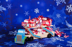 Christmas gifts. Truck overloaded with Christmas gifts Royalty Free Stock Images