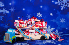 Christmas gifts. Truck overloaded with Christmas gifts Royalty Free Stock Photos