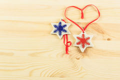 Christmas gifts, two creamic snowflakes on the woodden backgroun Stock Photography