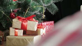 Christmas gifts under the Christmas tree. Christmas gifts are placed under the Christmas tree stock video footage
