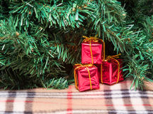 Christmas gifts under Christmas tree. Red gifts are under the Christmas tree on the rug and waiting for the holiday Stock Images