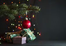Christmas gifts under a pine tree Royalty Free Stock Photos