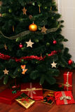 Christmas Gifts Under Tree Stock Image