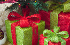 Christmas gifts under tree with lights, fir and decorations Royalty Free Stock Images