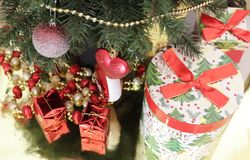 Christmas gifts under tree stock images