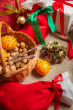 Christmas gifts and walnuts on the table Royalty Free Stock Images