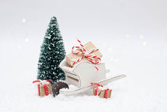 Christmas gifts. Wheelbarrow with Christmas gifts and christmas tree Stock Photo