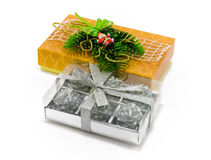 Christmas gifts on white. Two Christmas gifts of silver and yellow colors  on white Stock Photo