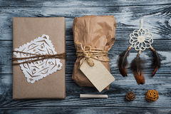 Christmas gifts on wooden background royalty free stock photo
