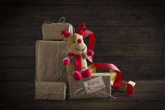 Christmas gifts on a wooden background Royalty Free Stock Photo