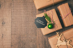 Christmas gifts on wooden background. Retro filter effect. View from above. Christmas gifts on wooden background. Retro filter effect Stock Photo