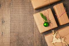 Christmas gifts on wooden background. View from above. Christmas gifts on wooden background Royalty Free Stock Image