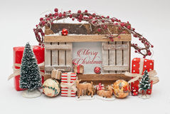 Christmas gifts. Wooden frame with christmas gift and decoration Royalty Free Stock Photography