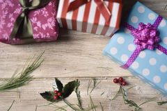 Christmas gifts on a wooden surface Stock Images