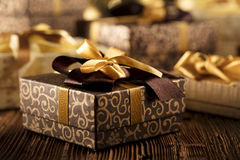 Christmas gifts. On wooden table Royalty Free Stock Photos