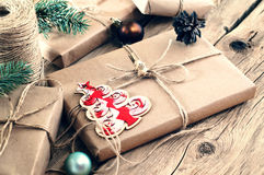 Christmas gifts on wooden table closeup. Rural or wooden style Royalty Free Stock Photos