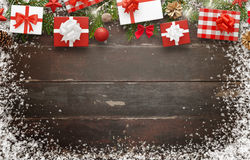 Christmas gifts on wooden table with free space for text. Top view of table. Christmas tree and decorations beside Royalty Free Stock Photo