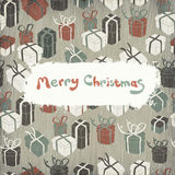 Christmas gifts on wooden texture. Royalty Free Stock Photography