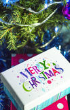 Christmas gifts and the words Merry Christmas Stock Photos