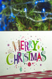 Christmas gifts and the words Merry Christmas Royalty Free Stock Photography
