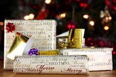 Christmas gifts wrapped. Wrapped Christmas gifts with tags in a festive scene stock image