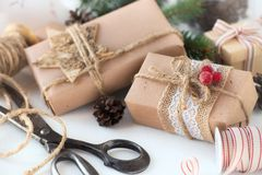 Christmas gifts wrapped in kraft paper Stock Photography