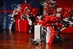 Christmas Gifts wrapped in wonderful coloured paper royalty free stock photo