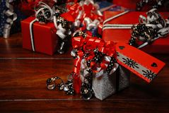 Christmas Gifts wrapped in wonderful coloured paper. Christmas Gifts wrapped in coloured paper on wooden table in wonderful colours presents stock image