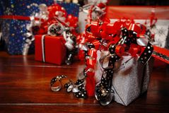 Christmas Gifts wrapped in wonderful coloured paper stock photo
