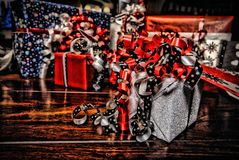 Christmas Gifts wrapped in wonderful coloured paper HDR stock image