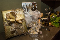 Christmas Gifts wrapped in an elegant setting Royalty Free Stock Images