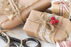 Christmas gifts wrapped in kraft paper Stock Images