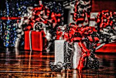 Christmas Gifts wrapped in wonderful coloured paper HDR stock photography