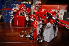 Christmas Gifts wrapped in wonderful coloured paper royalty free stock image